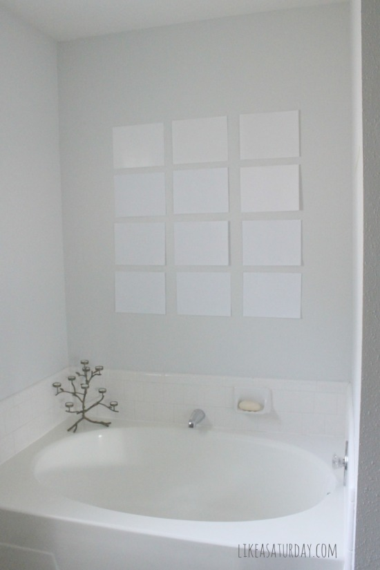 Master bath gallery wall  -- hang sheets of paper to plan your wall before hanging frames